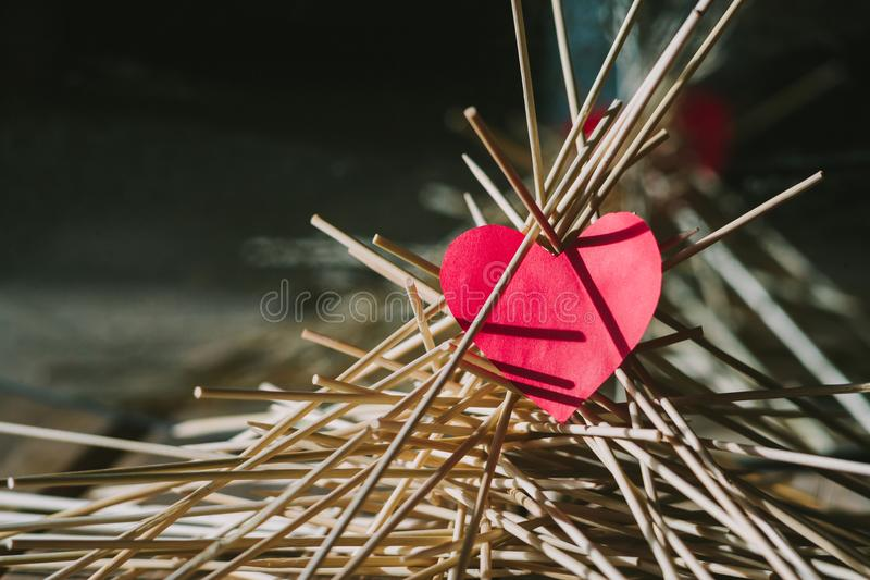 The paper heart lies on the wooden sticks. idea royalty free stock images