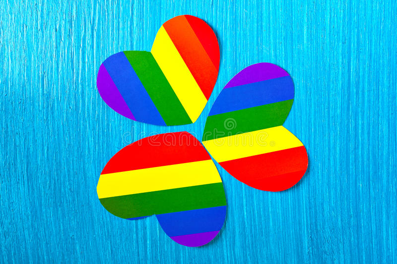 Paper heart symbol colors of the rainbow. Homosexual relationships. Three paper hearts of the rainbow. Flag Colors of homosexuality. the relationship between the stock image