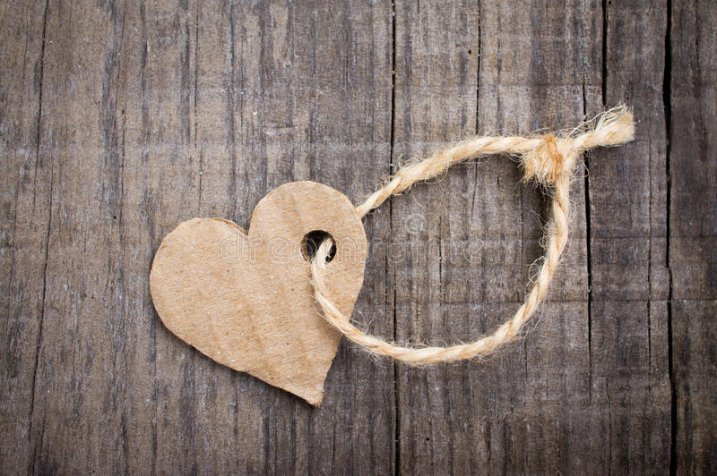 Paper Heart Tag. A Paper Heart Tag on wooden background stock image