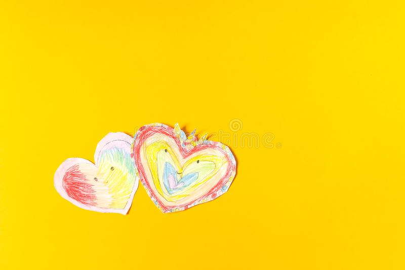 Paper hearts. Child& x27;s creation for Valentine& x27;s day. Paper hearts on bright yellow paper background. Child& x27;s creation for Valentine& x27;s day stock photography