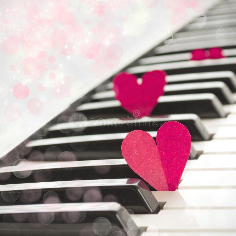 Paper hearts on piano stock photo
