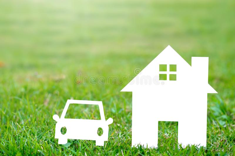 Paper House and car on field bokeh background copy space royalty free stock photo