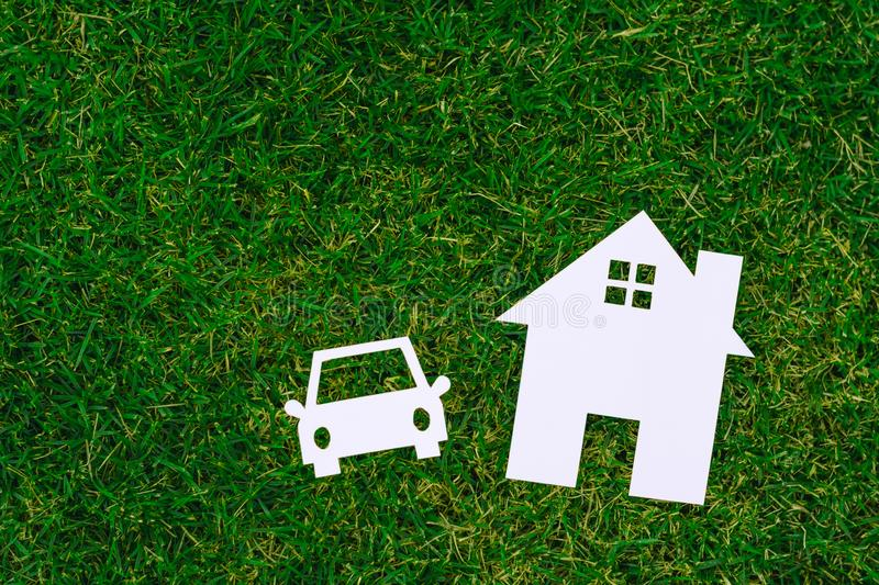 Paper House and car on field bokeh background copy space royalty free stock images