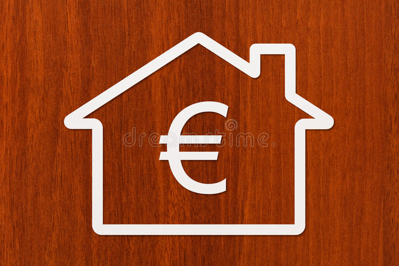 Paper house with euro sign inside. Abstract conceptual image stock images