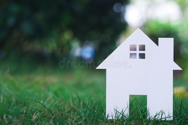 Paper House on field bokeh background copy space royalty free stock photos