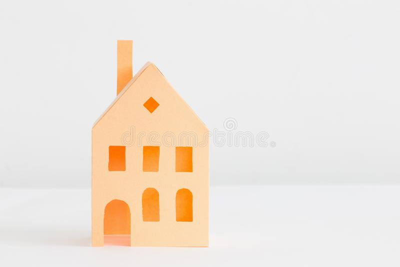 Paper house  on white background. Orange paper house  on white background stock photo