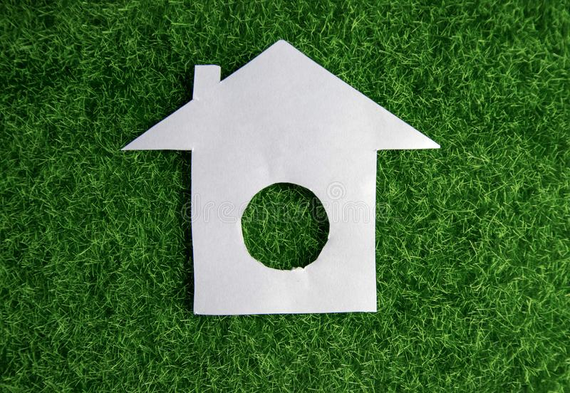 Paper house on the lawn. Ecology, nature stock images