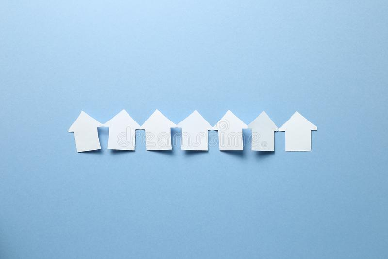 Paper house model on blue background. Real estate concept stock photo