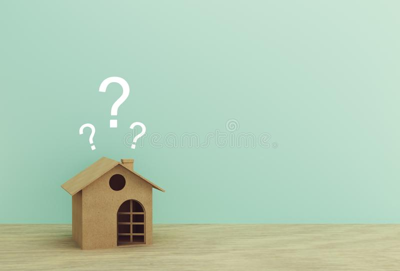 Paper house model with question marks on wood table with blue background. copy space for your text.  stock image