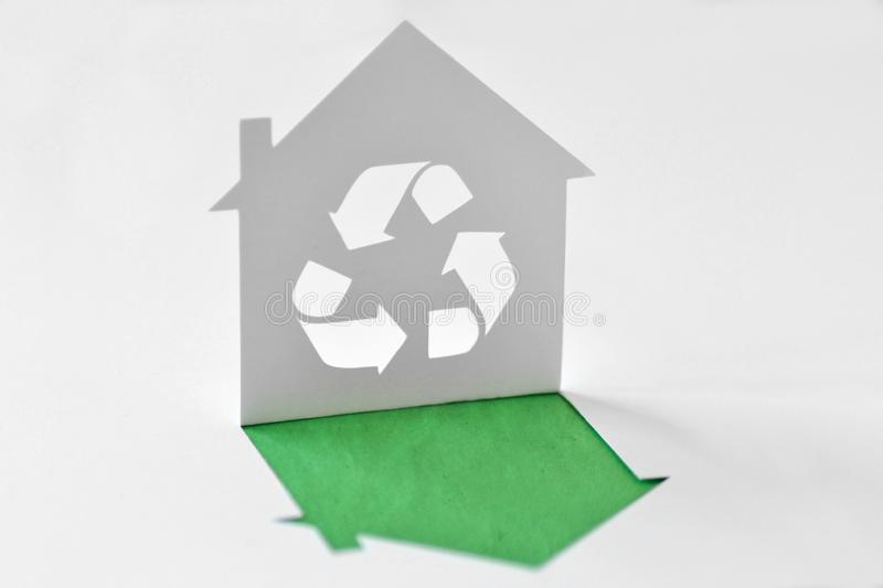 Paper house with recycling symbol - Ecology concept stock image