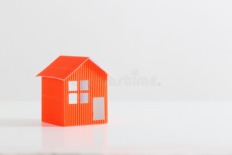 Paper house on white background. Orange paper house on white background stock photos
