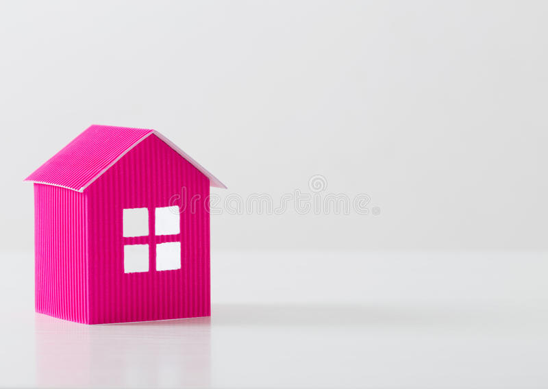 Paper house on white background. Pink paper house on white background stock photography
