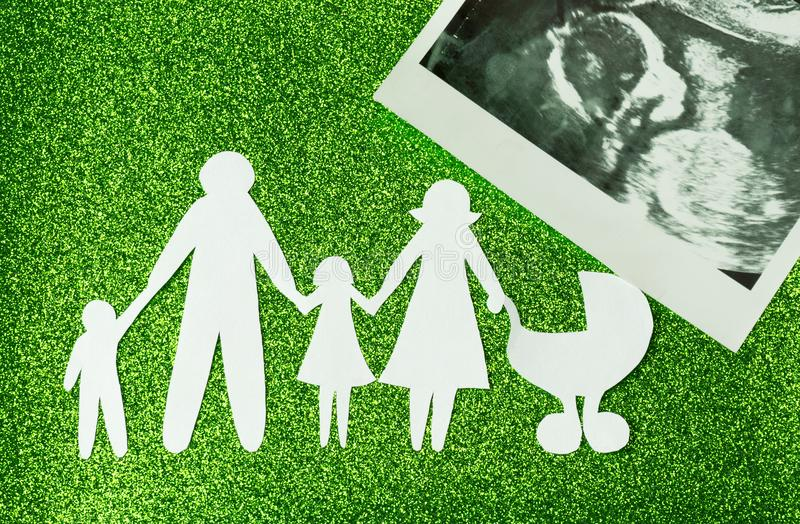 Paper image of happy families who are expecting another child.  stock images