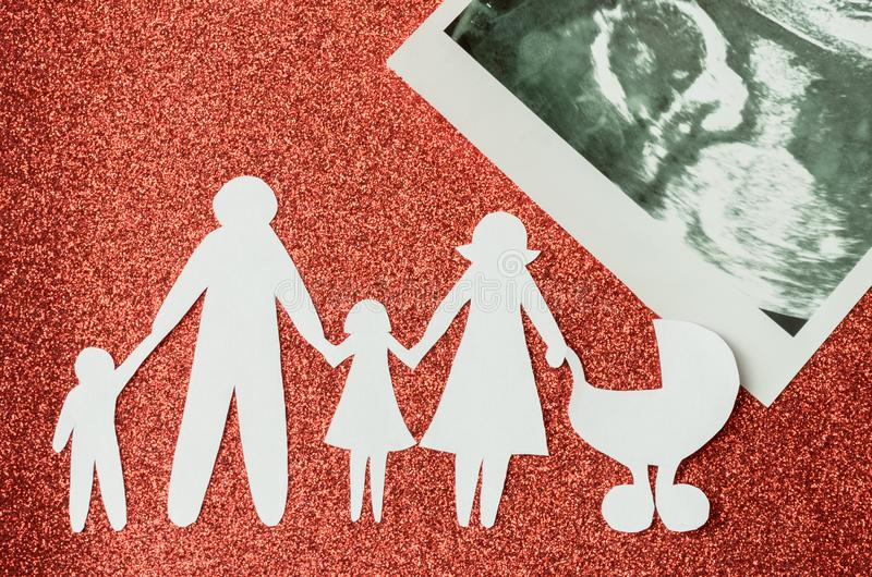 Paper image of happy families who are expecting another child.  stock photos