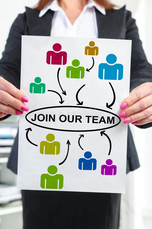 Join our team concept shown by a businesswoman. Paper with join our team concept held by a businesswoman stock image