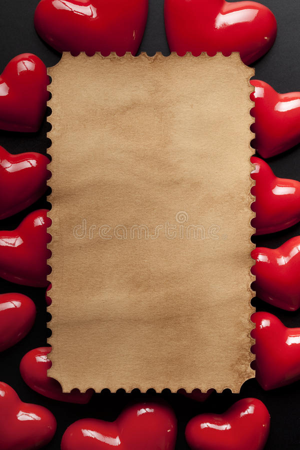 Paper label and red hearts on black background stock photo
