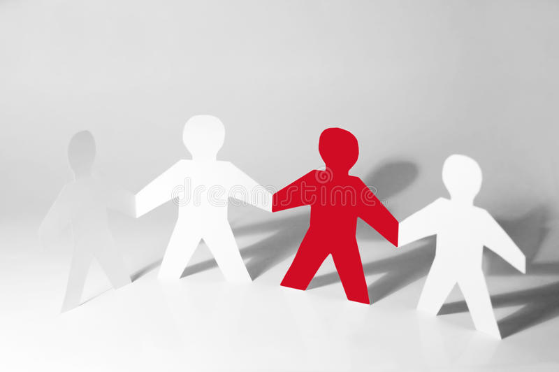 Paper little men holding hands royalty free stock photography