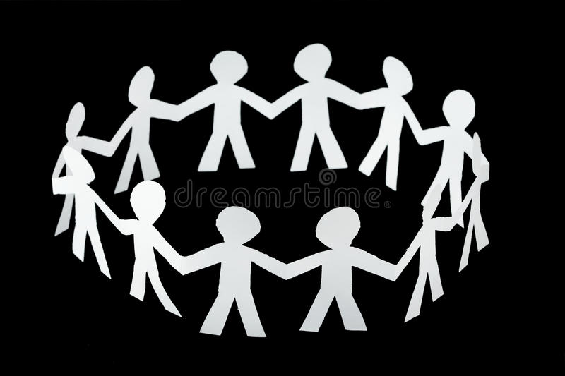 Paper little people cutouts dance in ring royalty free stock photography