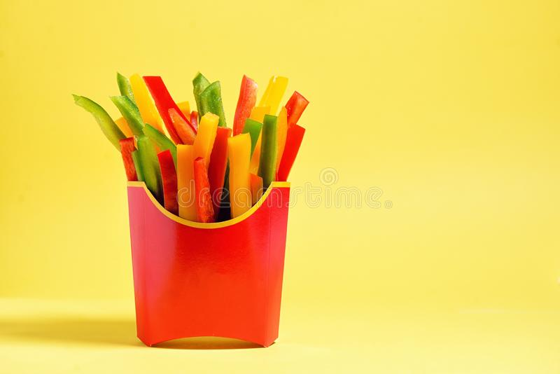 Paper lunch boxes with fresh bell peppers. Paper lunch boxes with fresh raw bell peppers royalty free stock photos