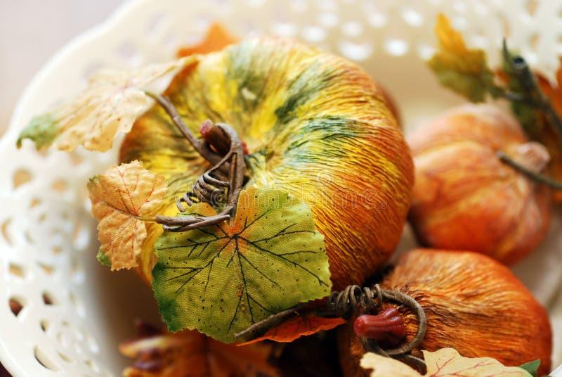 Paper Mache Pumpkins. Trio of paper mache pumpkins in a ceramic centerpiece bowl royalty free stock images