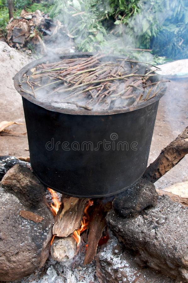 Download Paper Making - Cook stock photo. Image of tanzania, stove - 21072068