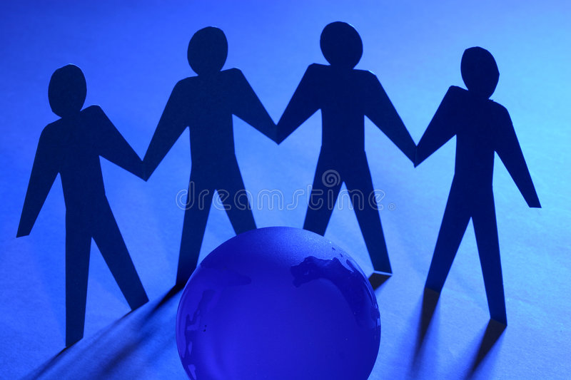 Paper Men. Unity and Teamwork Concept: Paper people gathered around globe holding hands