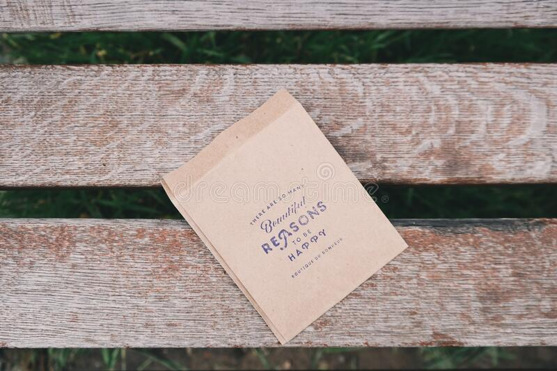 Paper with message on bench royalty free stock photo