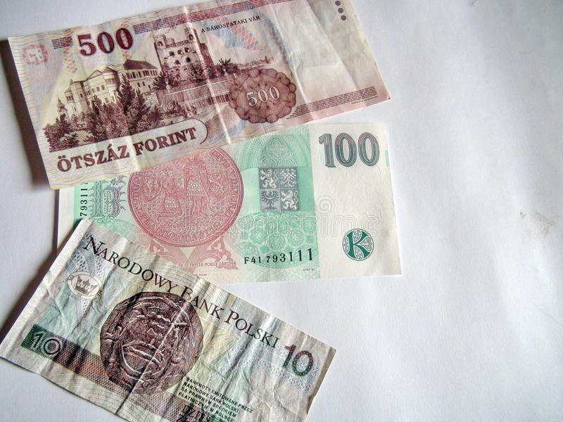 Paper money of the countries of the world. Eastern European banknotes: Hungarian forints, Czech kroner and Polish zloty. royalty free stock photos