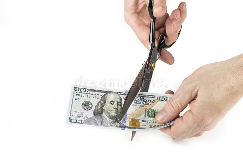 Paper money cut with scissors. Devaluation concept.  royalty free stock photos