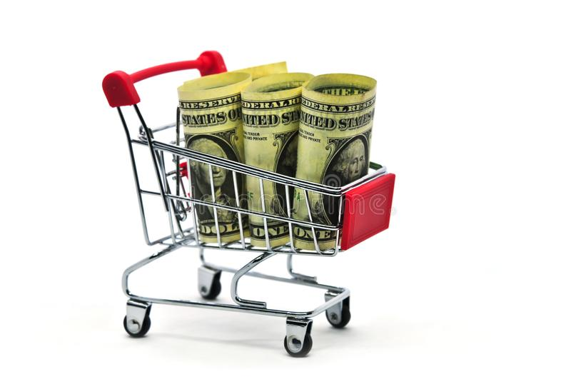 Paper money dollars Cash Banknote in Trolley Shopping Cart isolated on White Background royalty free stock photography