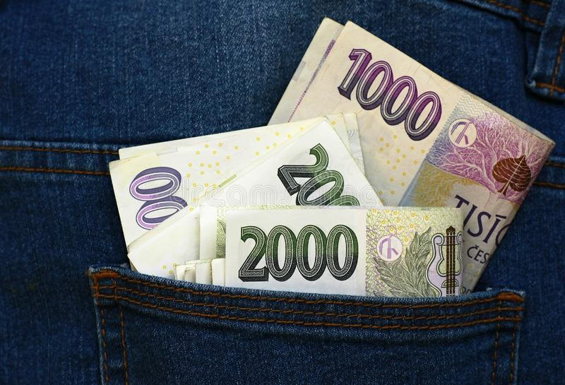 Paper money in the pocket of jeans. stock photo