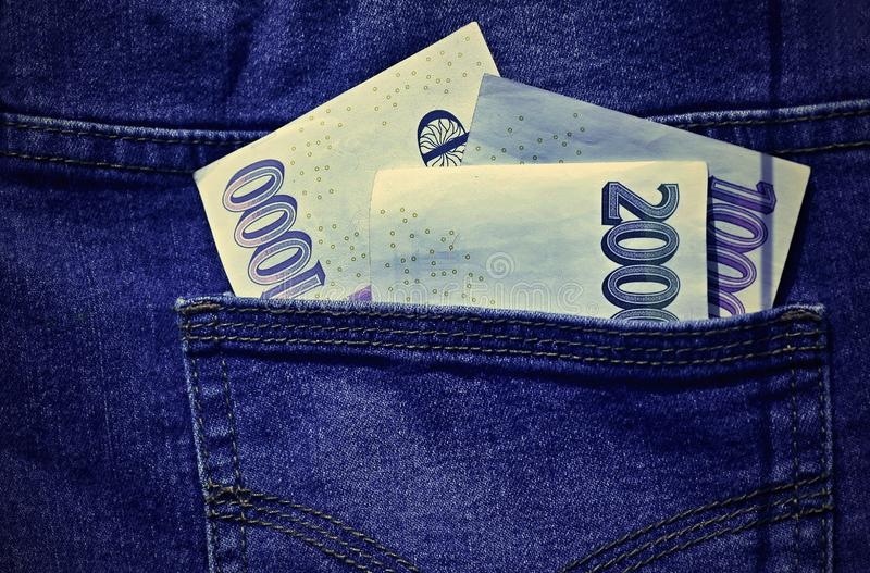 Paper money in the pocket of jeans. stock photos