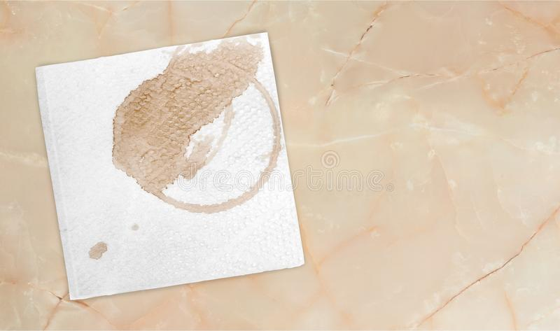 Paper Napkin with a coffee circle on background. Circle paper coffee napkin bar white background royalty free stock photography