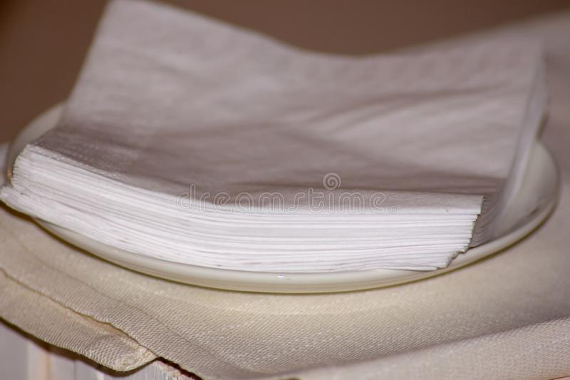 Paper napkins laid on a saucer in an orderly manner ready for those who want to use them. royalty free stock photos
