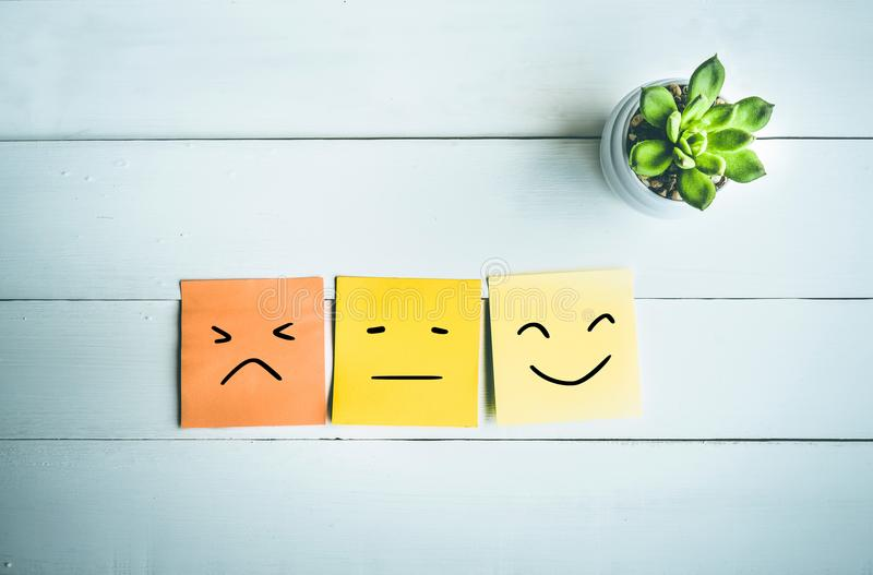 Paper note with emoticon face. Ideas royalty free stock image