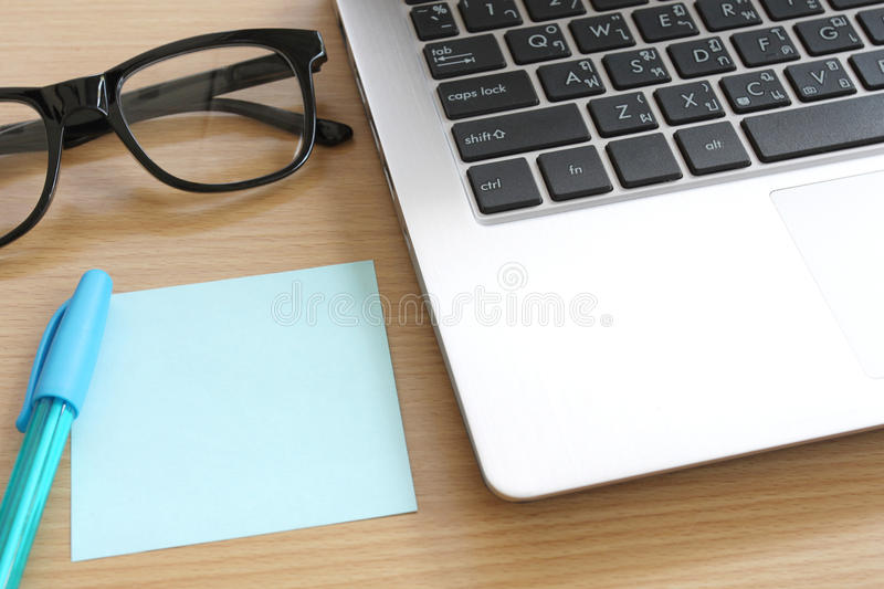 Paper note on the wooden work table. Paper note on the wooden work table you can input text to copy space in Business concept royalty free stock photography