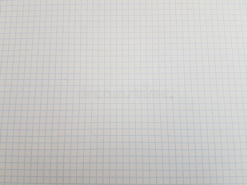 Paper notebook sheets empty blank squared lines spiral office page. School exercice book stock photo