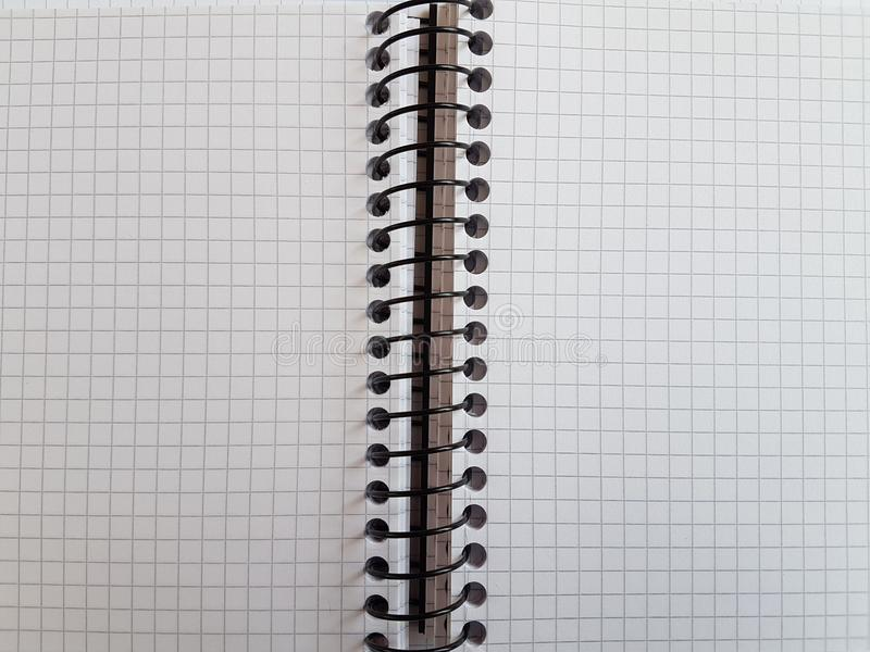 Paper notebook sheets empty blank squared lines spiral office page. School exercice book royalty free stock images