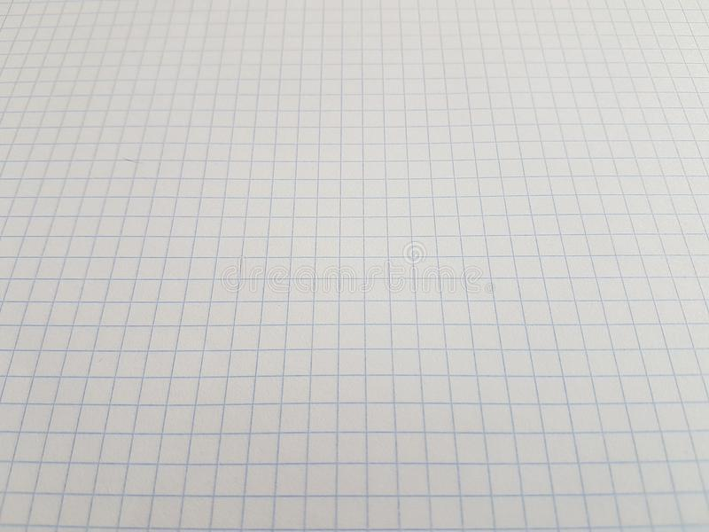 Paper notebook sheets empty blank squared lines spiral office page. School exercice book royalty free stock photos