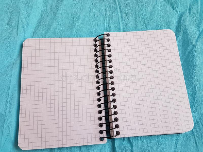 Paper notebook sheets empty blank squared lines spiral office page. School exercice book stock images
