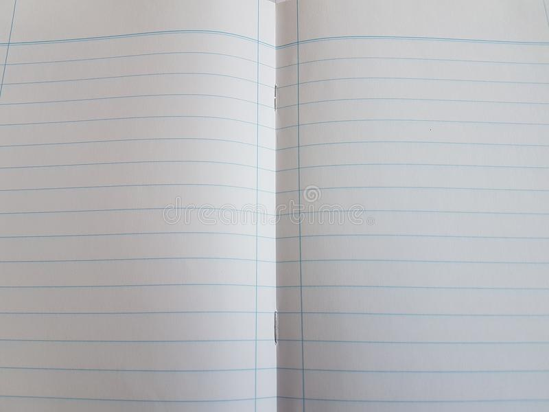 Paper notebook sheets empty blank squared lines spiral office page. School exercice book royalty free stock photography