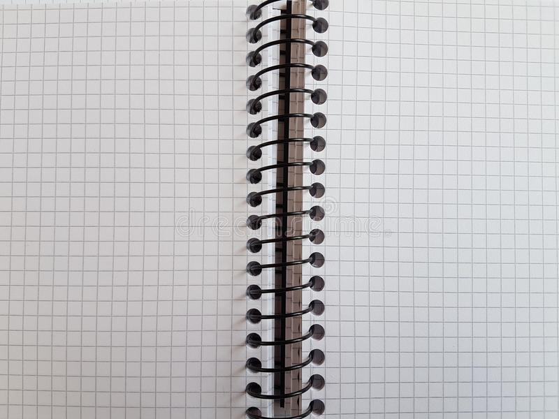 Paper notebook sheets empty blank squared lines spiral office page. School exercice book stock image