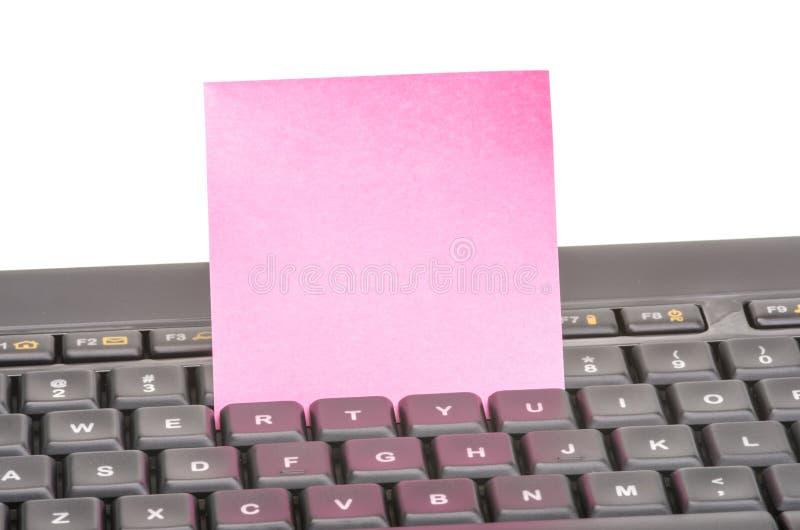 Paper noterar skrivar på arkivbild