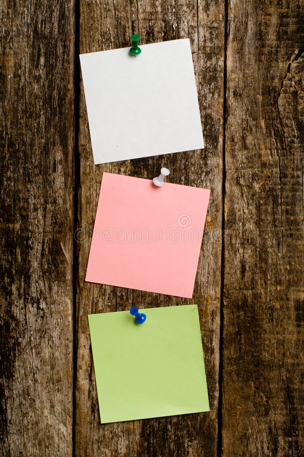 Paper notes in the wooden wall stock images