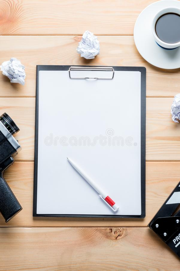 Paper and objects for the film industry on a wooden background t. Op view stock images