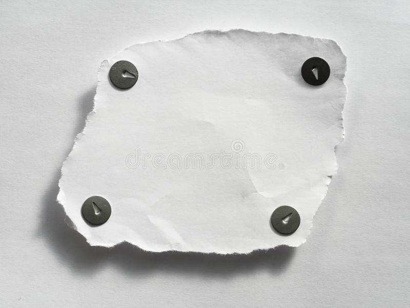 Paper with old thumbtacks stock image