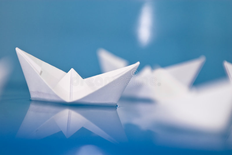 Paper origami boats royalty free stock photos