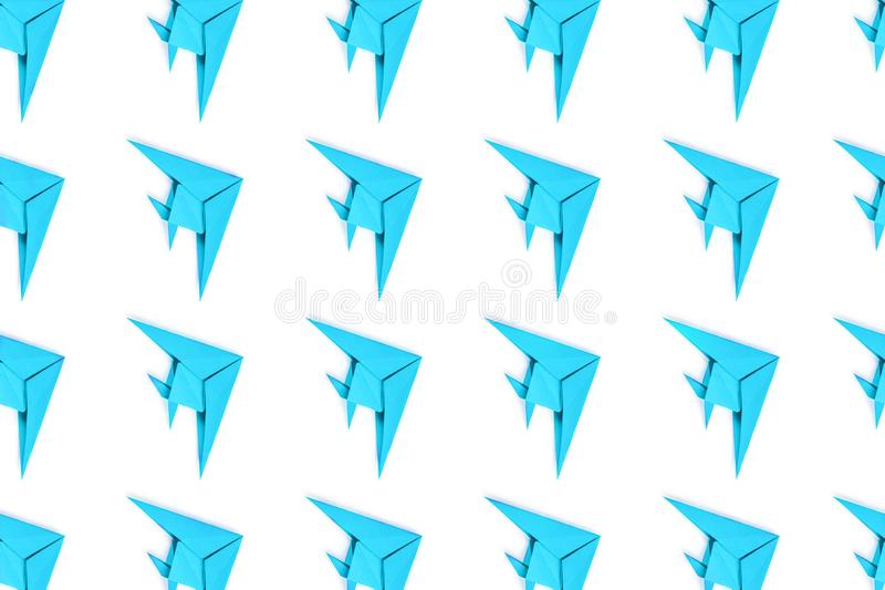 Paper origami fishes isolated on white background. Pattern of blue paper origami fishes isolated on white background royalty free stock photo