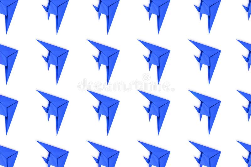 Paper origami fishes isolated on white background. Pattern of blue paper origami fishes isolated on white background stock photos