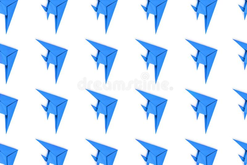 Paper origami fishes isolated on white background. Pattern of blue paper origami fishes isolated on white background stock photo